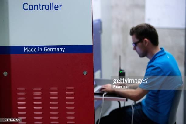 The words 'Made in Germany' sit on a door panel inside the control center during testing at the Thyssenkrupp Elevator AG test tower in Rottweill...