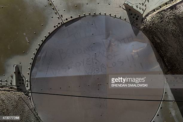 The words of Robert Oppenheimer an inventor of the atomic bomb are seen written in dust on part of a deactivated nuclear missile at the Pima Air and...