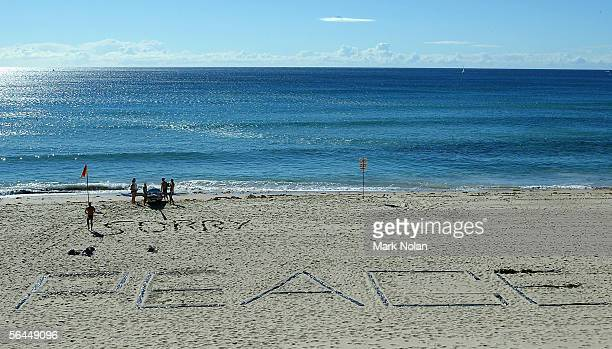 The words 'Sorry' and 'Peace' are seen in the sand at a deserted North Cronulla Beach December 18 2005 in Sydney Australia 1500 police are patroling...