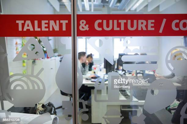 The words Talent Culture sit on glass panels as employees work in an office inside the Delivery Hero AG headquarters in Berlin Germany on Friday Dec...
