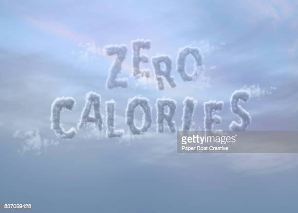the words zero and calories that appear to be clouds in the sky forming the phrase zero calories against a dark bluish purple background - typographies stock photos and pictures