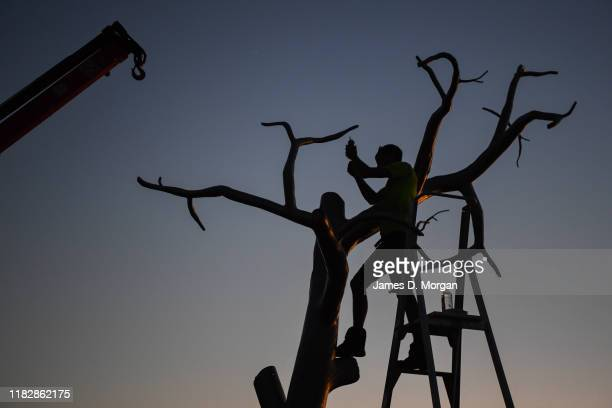 The work entitled 2030 by Sam Hopkins in pictured at sunset at Sculpture By The Sea at Bondi Beach on October 23 2019 in Sydney Australia The annual...