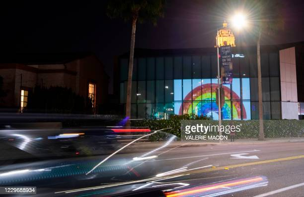"The work of 40 artists is projected onto the wall of the Wallis Annenberg Center for Performing Arts during the ""Visions in Light: Windows on The..."