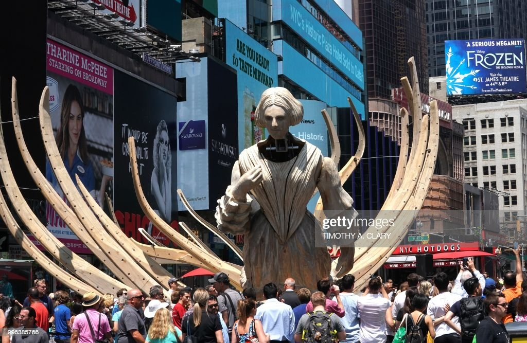 The work of artist Mel Chin, 'Wake' and 'Unmoored, is unveiled on Times Square July 11, 2018 in New York, part of the mixed reality piece developed with Microsoft. - Visitors will be invited to engage with the sixty-foot animatronic installation, evoking the hull of a 19th century shipwreck crossed with the skeletal remains of a marine mammal through through their mobile devices or a Microsoft HoloLens headset. (Photo by TIMOTHY A. CLARY / AFP) / RESTRICTED