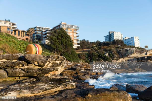 The work 'That's a Tasty Burger' by James Dive at Sculpture By The Sea at Bondi Beach on October 19 2017 in Sydney Australia