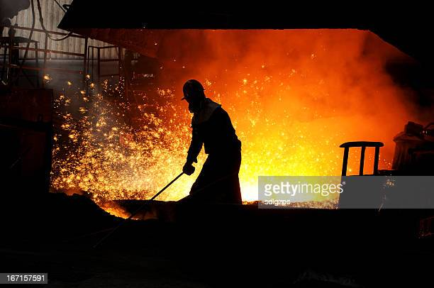 The worker in front of blast furnace