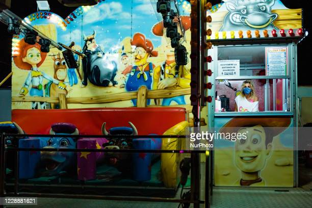 The worker of an attraction waiting for customers at the Luna Park in Molfetta at Secca dei Pali on 3 October 2020 First day of opening of the Luna...