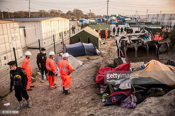 The workers destroyed the tents and huts of refugees around the Welcome Centre Provisional where minors are allowed in Calais October 26 2016 The...