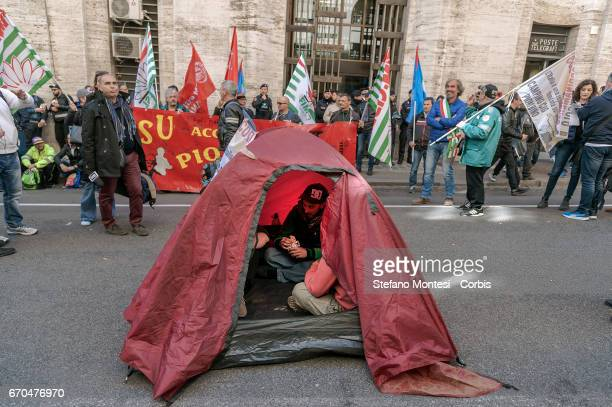 The workers pitcha a tent during the demonstration of plant workers to Aferpi of Piombino in front of the Ministry of Economic Development asking for...