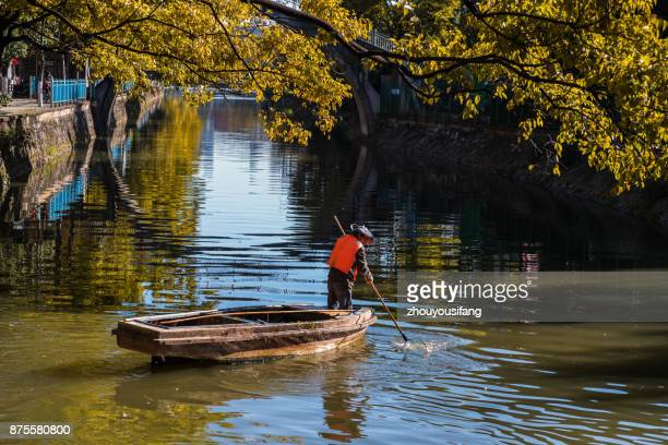 the workers who are cleaning the river - who stock pictures, royalty-free photos & images