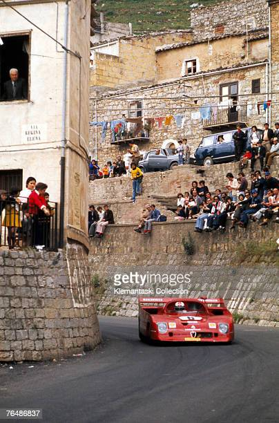The works Alfa Romeo 33TT12 driven by Rolf Stommelen and Andrea de Adamich rounds a village corner during the Targa Florio Sicily 13th May 1973 Like...