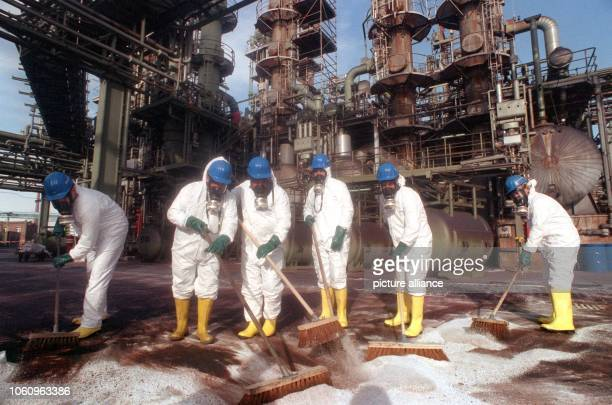 The works fire service in protective clothes clean the terrain of the Hoechst AG on the 22nd of February in 1993, where a severe chemical spill had...