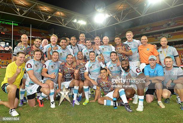 The World All Stars team celebrate their victory after the NRL match between the Indigenous AllStars and the World AllStars at Suncorp Stadium on...