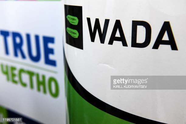 The World Anti-Doping Agency or WADA logo is pictured at the Russkaya Zima Athletics competition in Moscow on February 9, 2020. - The entire board of...