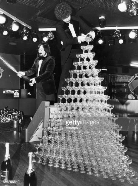 The world champagne fountain goes pop at Rotters night club in Liverpool with more than 700 glasses topped up with 14 gallons of champagne easily...