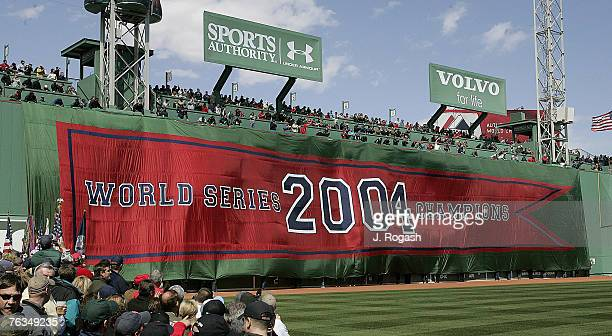 The World Champion banner for Boston Red Sox is displayed on the Green Monster at Fenway Park before a game with New York Yankees Monday, April 11 in...
