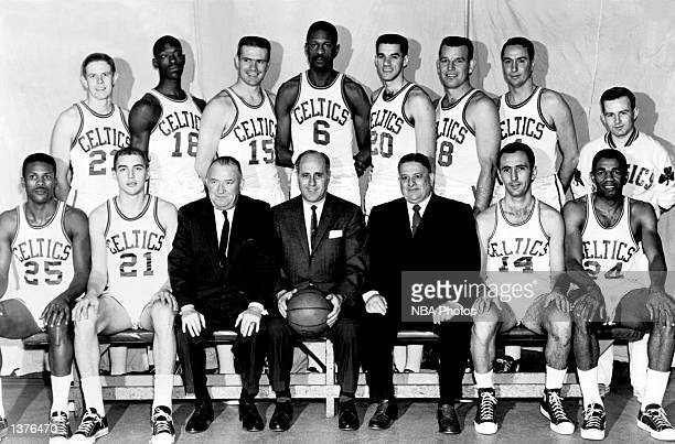 The World Champions of basketball Boston Celtics pose for a team portrait seated K C Jones Gary Phillips President Walter A Brown Head Coach Red...
