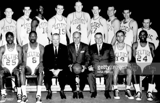 The World Champions of basketball Boston Celtics pose for a team portrait seated K C Jones Bill Russell President Walter A Brown Head Coach Red...