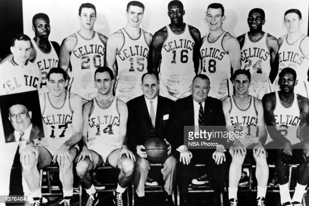 The World Champions of basketball Boston Celtics pose for a team portrait, seated : Gene Conley, Bob Cousy, head coach Red Auerbach, President Walter...
