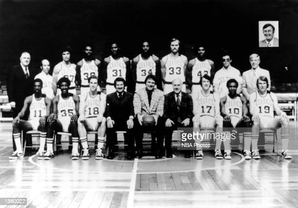 The World Champions of basketball Boston Celtics pose for a team portrait seated Charlie Scott Paul Silas Dave Cowens Chairman of the Board Irving...
