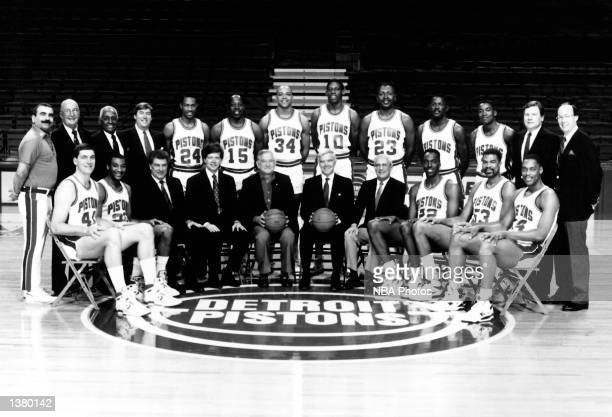 The World Champions of basketball Detroit Pistons pose for a team portrait seated Bill Laimbeer John Long Head Coach Chuck Daly Chief Executive...