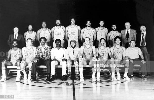 The World Champions of basketball Golden State Warriors pose for a team portrait front row Charles Johnson Jeff Mullins Joe Roberts Assistant Coach...