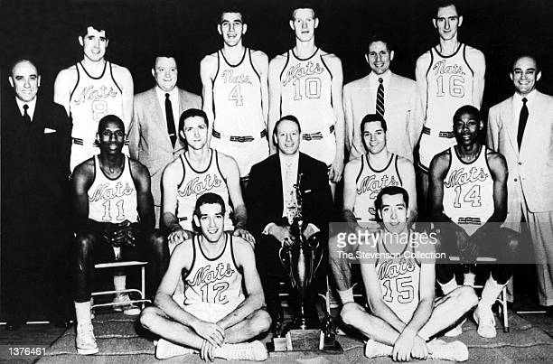The World Champions of basketball Syracuse Nationals pose for a team portrait front row Dick Farley Billy Kenville Center Row Earl Lloyd Captain Paul...