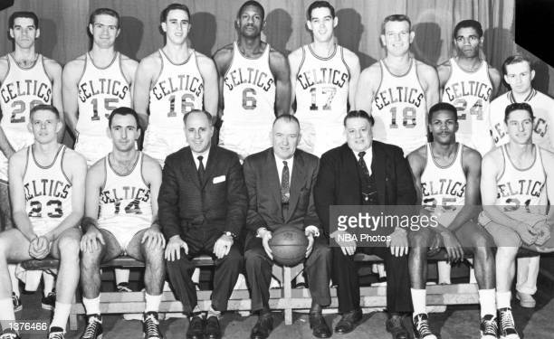 The World Champions of basketball the Boston Celtics pose for a team portrait seated Frank Ramsey Bob Cousy head coach Red Auerbach President Walter...