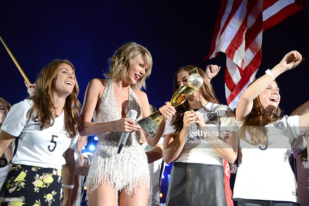 The World Cup champion U.S. Women's National Soccer Team and Taylor Swift onstage during The 1989 World Tour Live at MetLife Stadium on July 10, 2015 in East Rutherford, New Jersey.