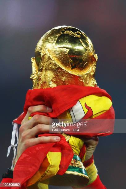 The World Cup is seen draped in a Spanish flag after the 2010 FIFA World Cup South Africa Final match between Netherlands and Spain at Soccer City...