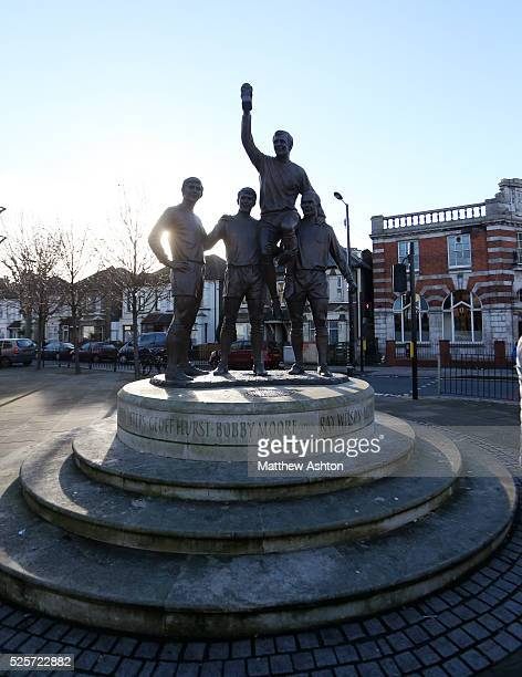 The World Cup Sculpture featuring Bobby Moore Geoff Hurst Martin Peters and Ray Wilson near The Boleyn Ground stadium home of West Ham United