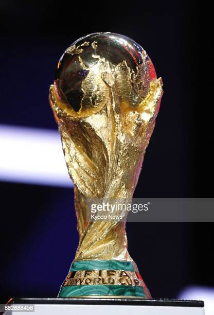 The World Cup soccer trophy is unveiled in Moscow on Nov 29 ahead of the draw for the 2018 tournament in Russia ==Kyodo