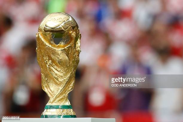 The World Cup trophy is displayed during the closing ceremony prior to the Russia 2018 World Cup final football match between France and Croatia at...