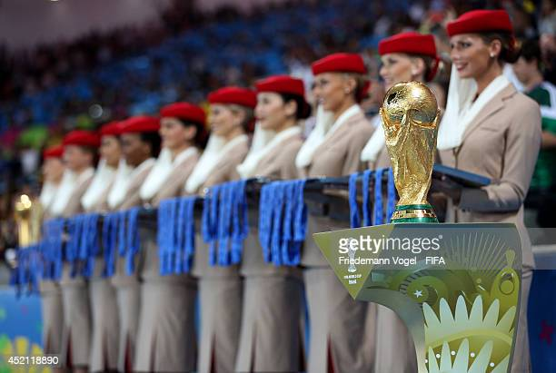 The World Cup trophy is presented during he award ceremony after the 2014 FIFA World Cup Brazil Final match between Germany and Argentina at Maracana...