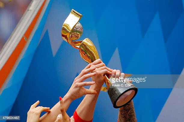 The World Cup Trophy is seen as the United States celebrates after winning the FIFA Women's World Cup Canada 2015 5-2 against Japan at BC Place...