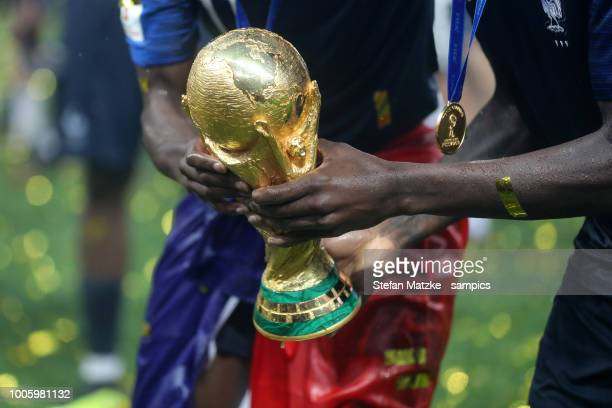 The World Cup trophy is seen in the hand of french player after the 2018 FIFA World Cup Russia Final between France and Croatia at Luzhniki Stadium...