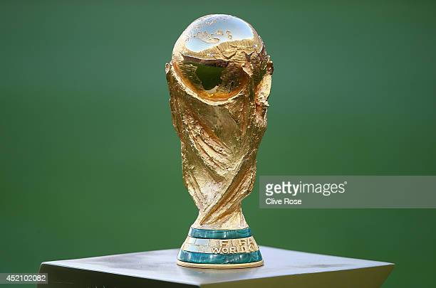 The World Cup trophy sits on display prior to the 2014 FIFA World Cup Brazil Final match between Germany and Argentina at Maracana on July 13, 2014...