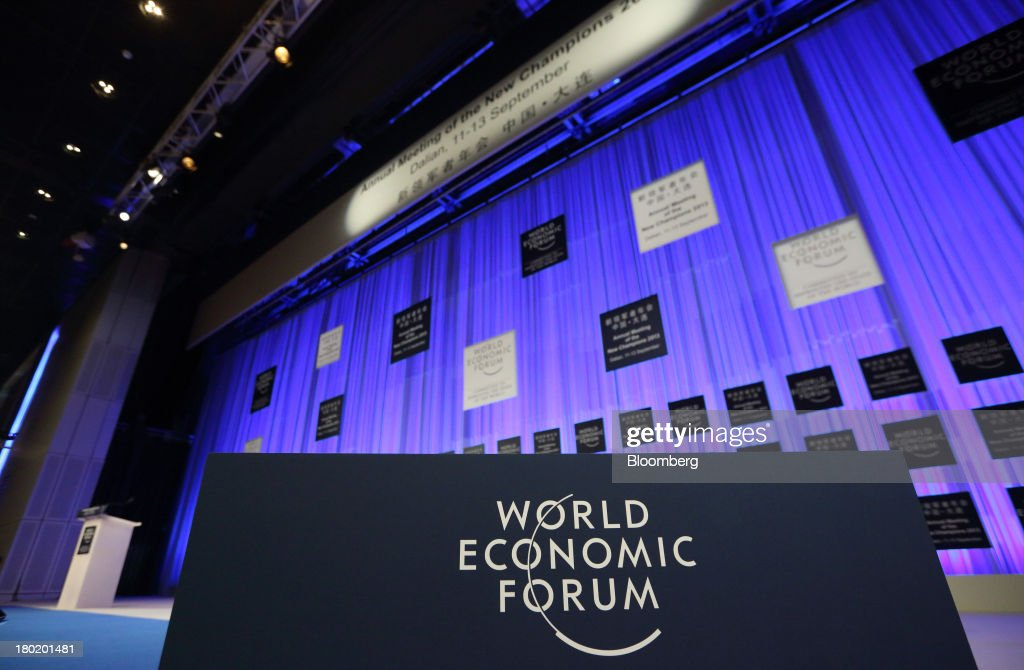 The World Economic Forum logo is displayed on the stage of the plenary hall in the Dalian International Conference Center in Dalian, China, on Tuesday, Sept. 10, 2013. The World Economic Forum Annual Meeting Of The New Champions 2013 will be held in Dalian from Sept. 11 to 13. Photographer: Tomohiro Ohsumi/Bloomberg via Getty Images
