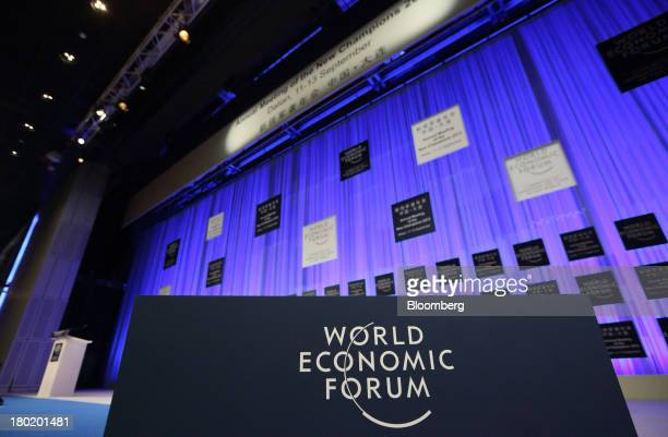 The World Economic Forum logo is displayed on the stage of the plenary hall in the Dalian International Conference Center in Dalian China on Tuesday...