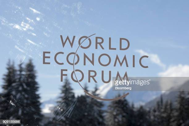The World Economic Forum logo sits on a pane of glass during on the opening day of the annual forum in Davos Switzerland on Tuesday Jan 23 2018 World...