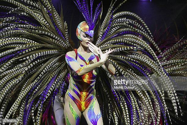 """The world famous French cabaret The Lido has unveiled in Paris their first new revue for 8 years called """"Bonheur"""" with Sabine Hettlich from Germany..."""