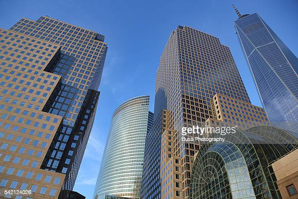 the world financial center in lower manhattan ( renamed brookfield place in 2014) with the one world trade center tower in the background, at sunset - new york stato foto e immagini stock