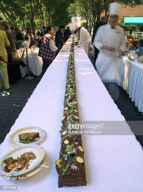 The world longest chocolate yule log 2790 meter long is being served 16 December 2003 in Mexico City The cake was registered in the Guinness Books of...