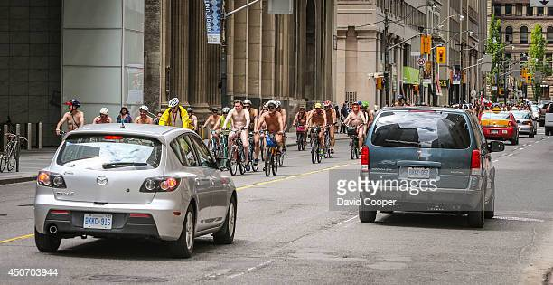 The World Naked Bike Ride brings several dozens of naked cyclists riding through downtown Toronto June 14 2014