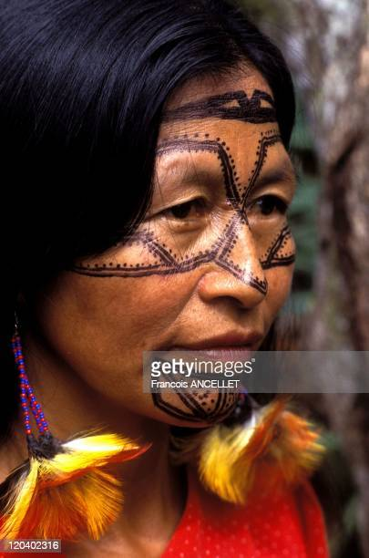 The world of Jivaro Indians in Ecuador in 1991 Jivaro Indian woman facial painting from the High Amazon Canelos Quichua ethnic group