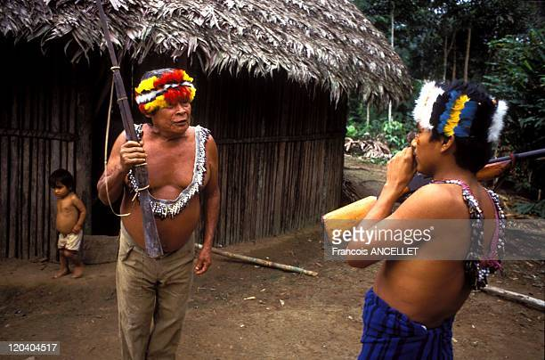 The world of Jivaro Indians in Ecuador in 1993 Jivaro greeting during a visit to a neighbor Never ending discussions and rites Tuutinentsa Shuar...