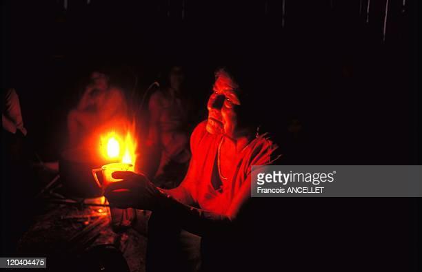 The world of Jivaro Indians in Ecuador in 1993 Jivaro Indian woman The Macas Shaman's wife serves the hallucinogenic decoction Shuar ethnic group...
