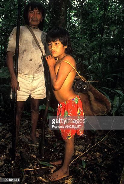 The world of Jivaro Indians in Ecuador in 1993 Pinientsa and his son Leaving to hunt the monkey Chorongo Rio Pindoyacu Achuar ethnic group Ecuadorian...