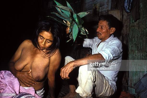 The world of Jivaro Indians in Ecuador in 1993 Shaman under hallucinogens treating a sick person Rio Curaray Achuar ethnic group Ecuadorian Amazon