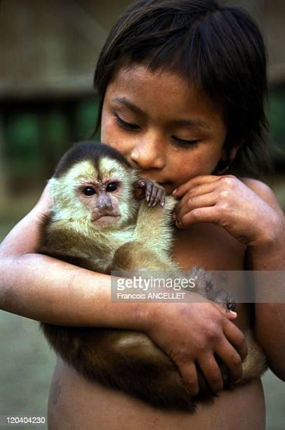 The world of Jivaro Indians in Ecuador in 1994 Achuar child and his monkey Rio Conambo Ecuadorian Amazon